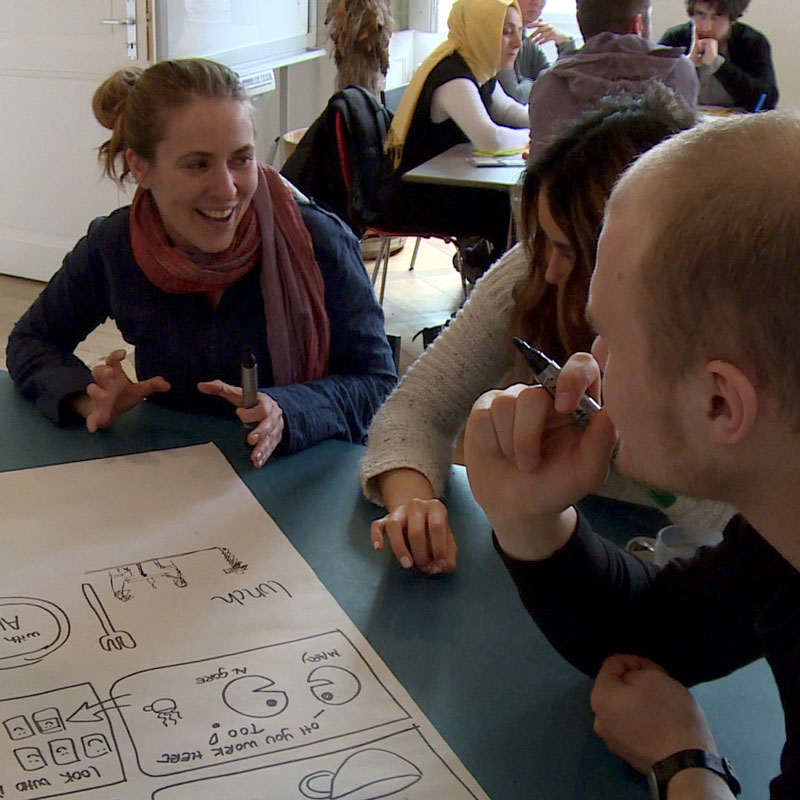 Photo of people talking together at the Impact Hub Geneva during the Co-design day